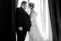 bride and groom portrait near window