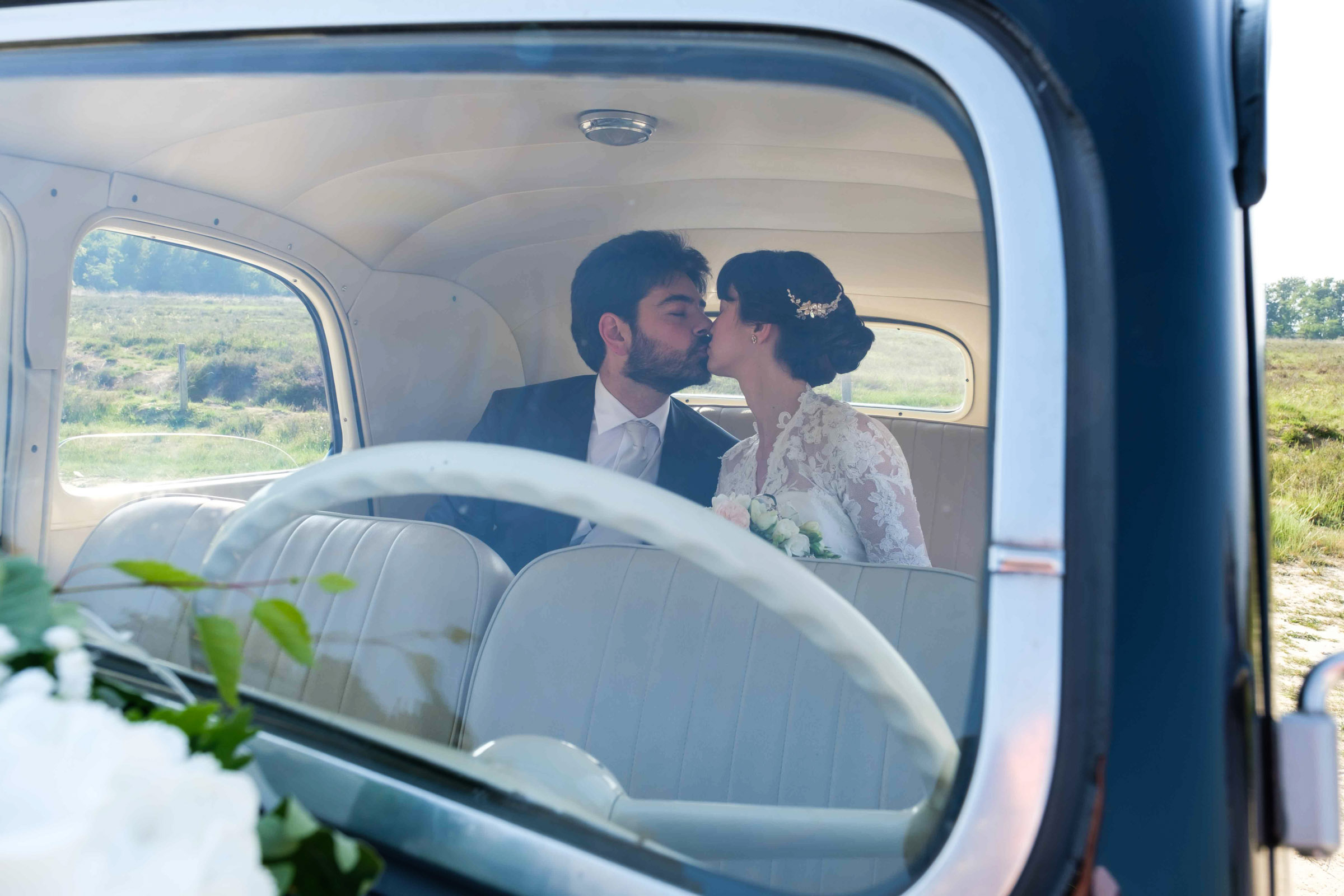 kiss in the wedding car